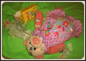 Patient Piggy had a lot of owies!  It took an ENTIRE box of Sponge Bob band-aides to fix her up.