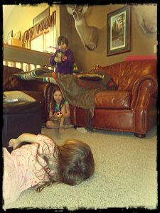 The little zombie attacked, but the big kids were ready barricaded in the corner of the room behind pillows with an airsoft M-16 (bullet-free) and a Nerf riffle.