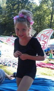 Rocking her fairy wings before performing on stage at a local amphitheater.